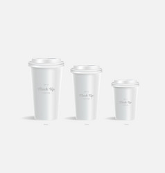 3 white coffee cups mockup on grey background vector