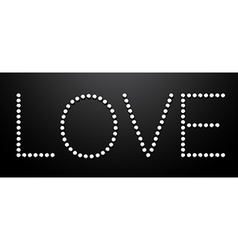 Love made from silver sequins on black background vector