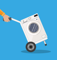 Metallic hand truck with washing machine vector