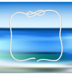 White rope frame on a blue sea blurred background vector
