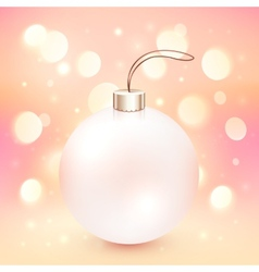 Pink Christmas ball on shining bokeh effect vector image