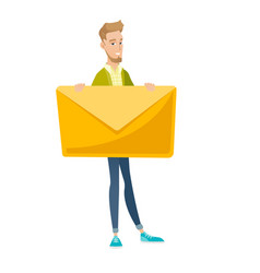 Young caucasian businessman holding big envelope vector
