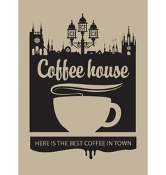 Cup of coffee and the old town with a street lamp vector