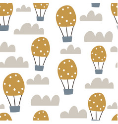 Childish seamless pattern with hot air ballon vector