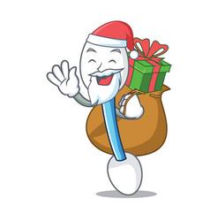 Santa with gift cotton swab mascot cartoon vector