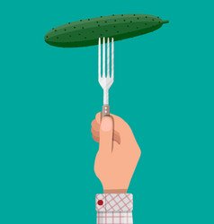 Cucumber vegetable on fork in hand vector