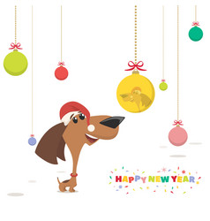 Christmas card puppy looks at a christmas ball vector