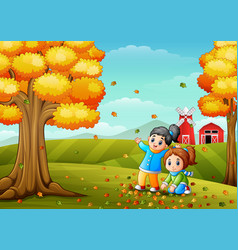 Happy kids playing with autumn leaves vector