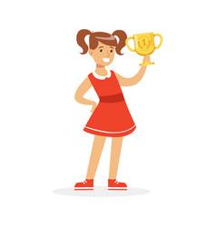 happy school girl in red dress holding winner cup vector image