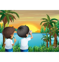 Two kids with a camera at the riverbank vector image