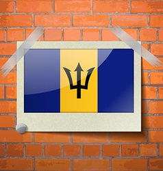 Flags Barbados scotch taped to a red brick wall vector image