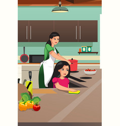 mother and daughter cooking in the kitchen vector image