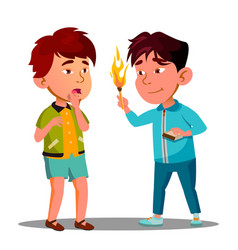 two little asian boys playing with matches vector image