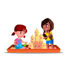 children build a sand castle in the sandbox in vector image