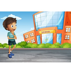 A young boy at the street across the school vector image