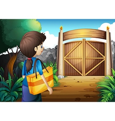 A woman with a bag walking towards the gate vector image vector image