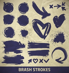 Ink brushstroke elements on paper background vector