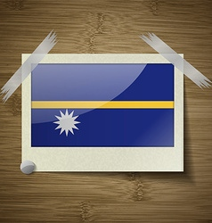 Flags Nauru at frame on wooden texture vector