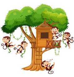 Monkeys playing at the treehouse vector