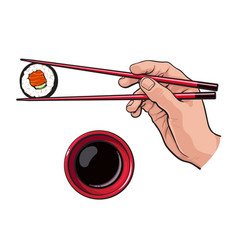 Eating sushi - human hand with chopsticks and soy vector