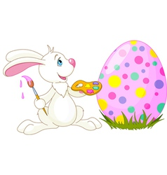 easter bunny painting an egg vector image vector image