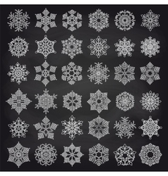 White showflakes set on chalkboard vector image