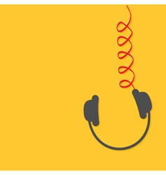 Hanging black headphones with red spring cord vector image