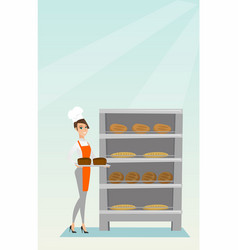 happy young baker holding a tray with bread vector image