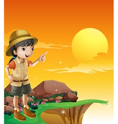 A female explorer standing near the cliff vector