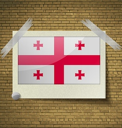 Flags Georgia at frame on a brick background vector image