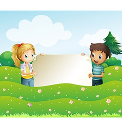 Two teens holding a wide empty signage vector image