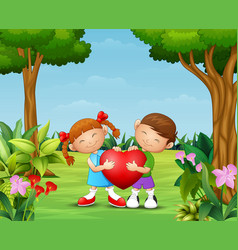 Cartoon happy couple kid holding a heart in the pa vector