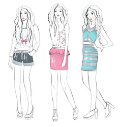 Young fashion girls in fashionable clothes posing vector image vector image