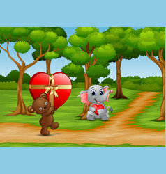 Cartoon of teddy bear and baby elephant carrying a vector