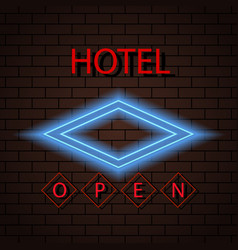 Neon signboard hotel sign on a brick wall vector