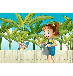 A girl holding a sprinkler near the wooden fence vector image