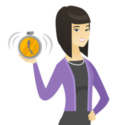 Asian business woman holding alarm clock vector