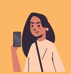 indian woman taking selfie photo on smartphone vector image