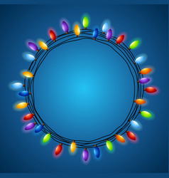 Christmas light frame on a blue background vector