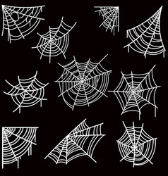Set of halloween spider web on dark background vector