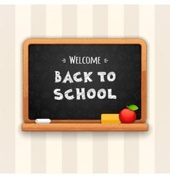 Welcome Back to School Written on Blackboard vector image