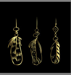 Luxury hand drawn golden feathers isolated on a vector