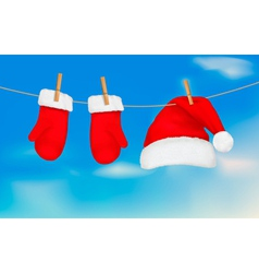 santa hat and mittens hanging vector image vector image