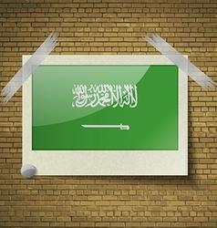 Flags Saudi Arabiaat frame on a brick background vector image vector image