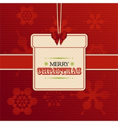 Christmas gift label on red embossed snowflakes vector image vector image
