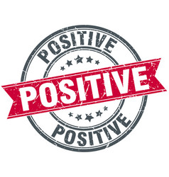 Positive round grunge ribbon stamp vector