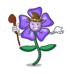 Witch periwinkle flower mascot cartoon vector