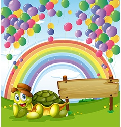 A turtle beside the empty board with a rainbow and vector