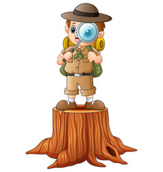 Boy explorer with magnifying glass on tree stump vector