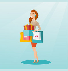 Woman holding shopping bags and gift boxes vector